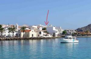 Mar Abierto  - La flecha señala los edificios a demoler en la primera línea de m